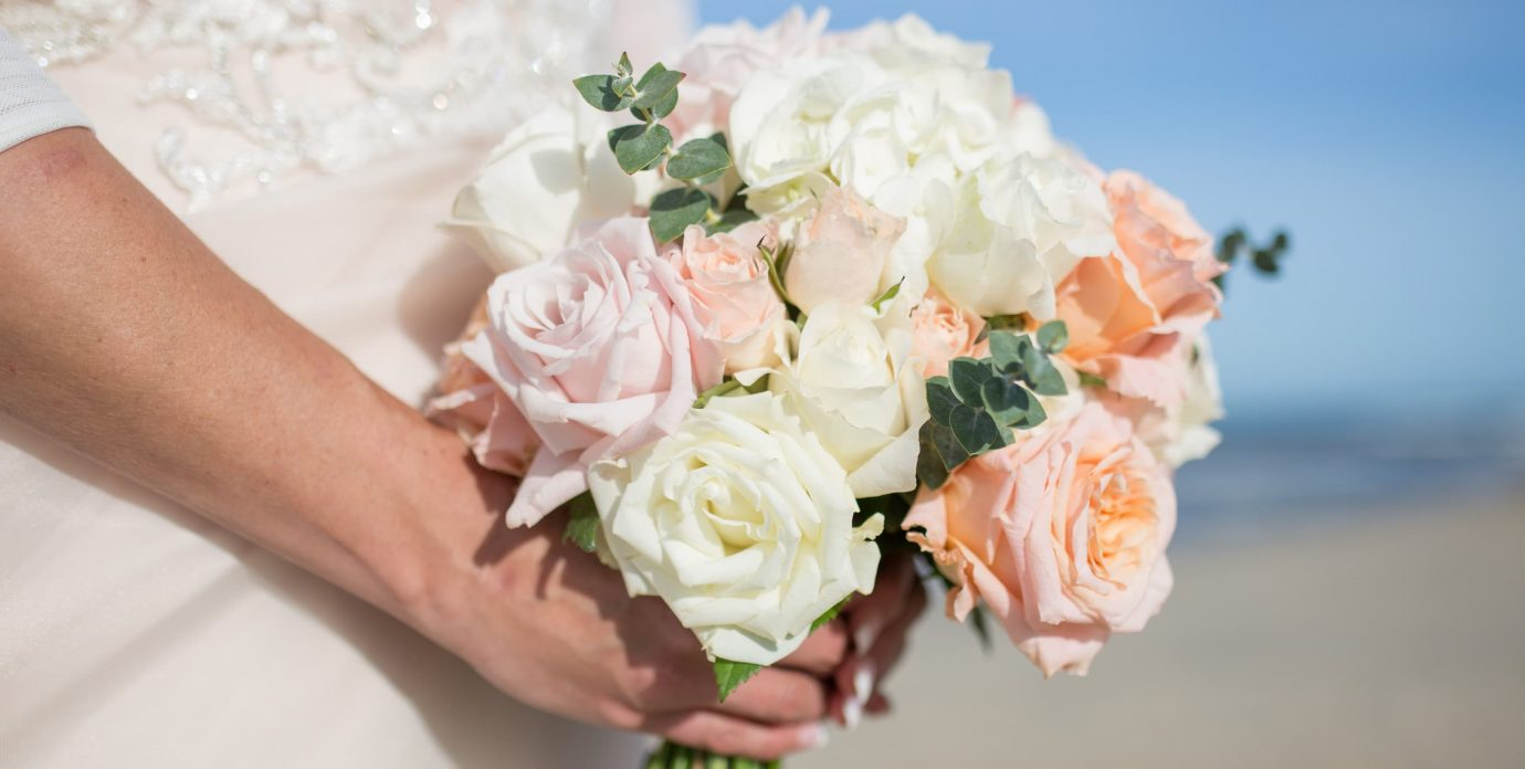 Bride Holding a Bouquet for Beach Elopement in Manteo NC
