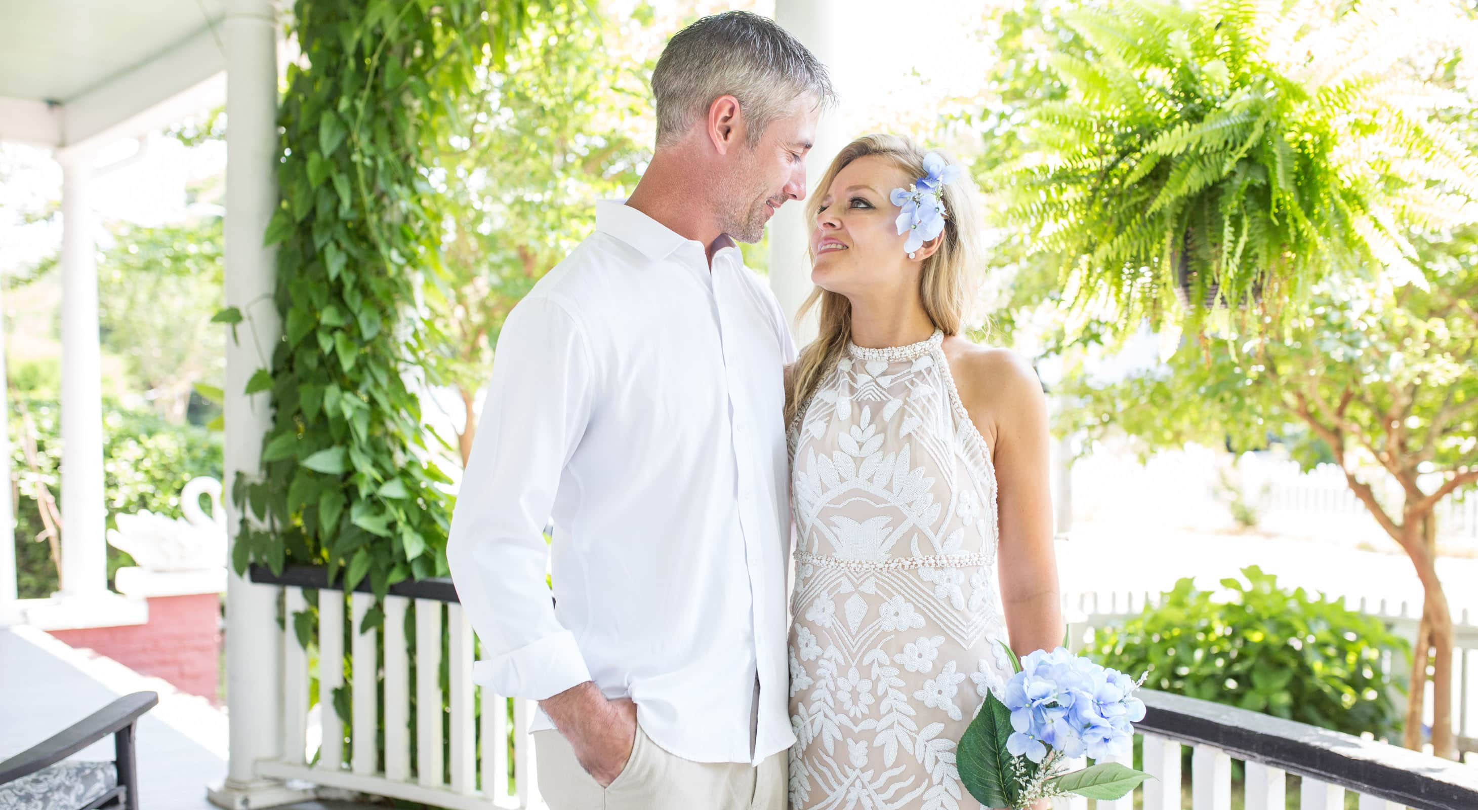 Bride and Groom on Porch at Our Outer Banks Elopement Venue