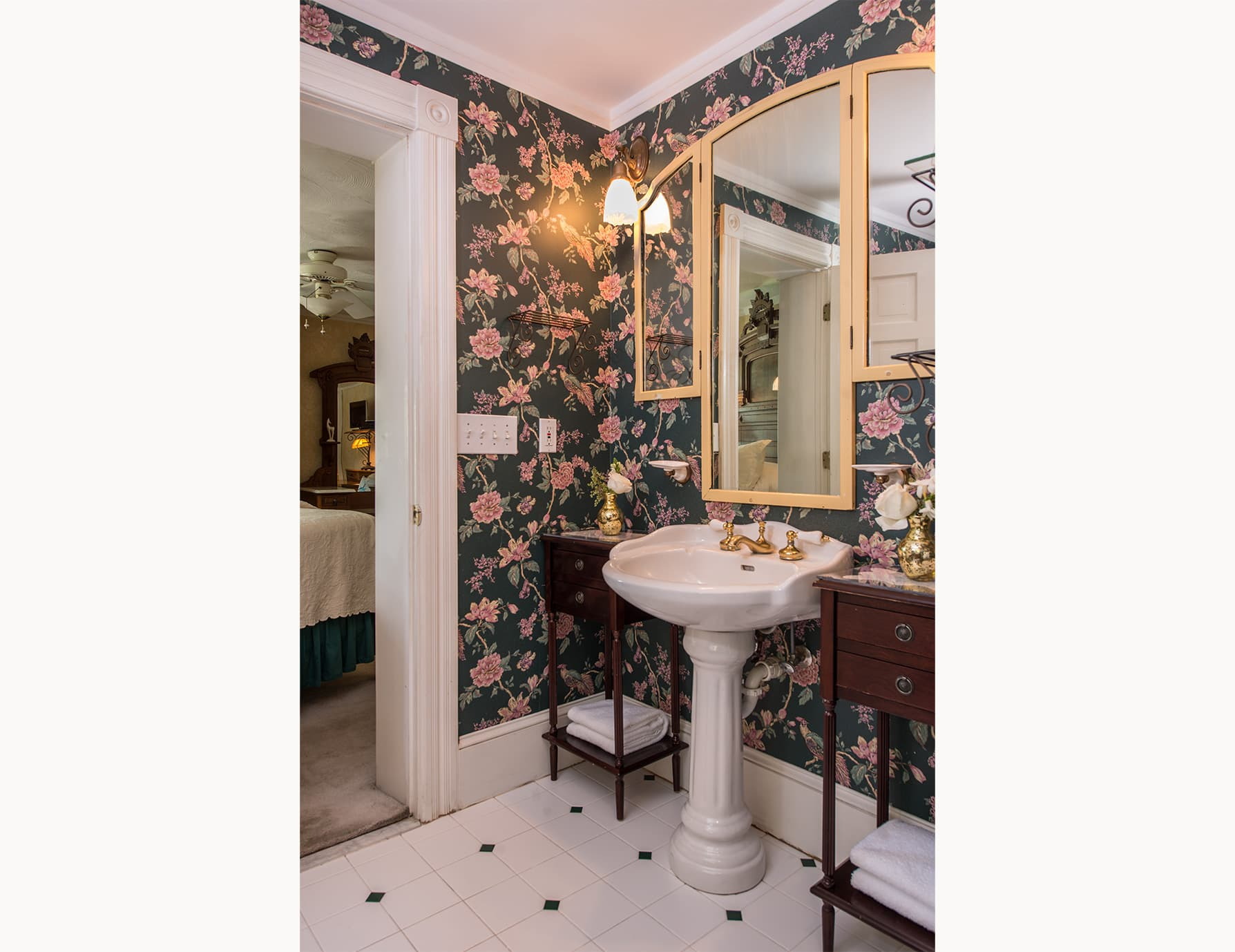 Bathroom with Floral Wallpaper at Our Bed and Breakfast on Roanoke Island