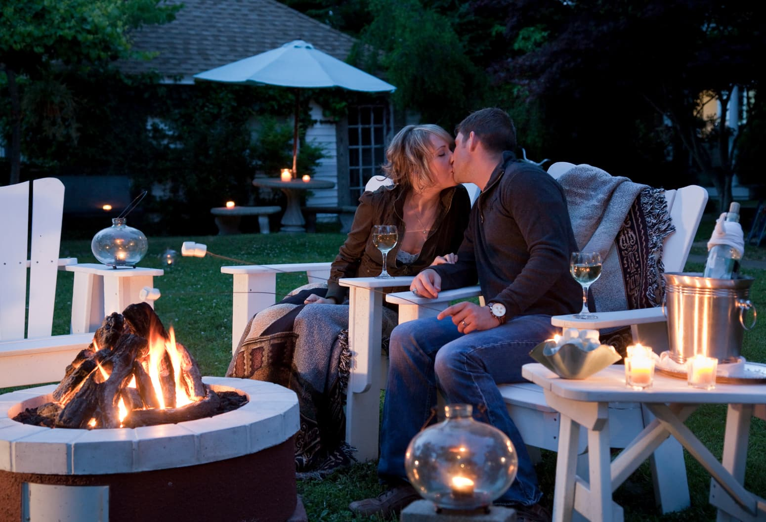 Couple Roasting Marshmallows on a Romantic Getaway on the Outer Banks