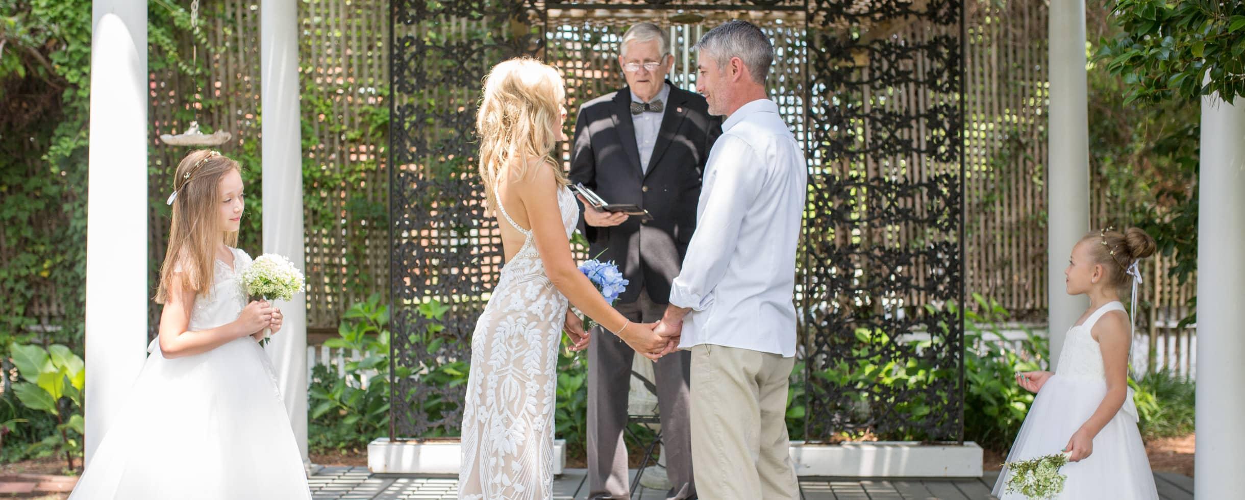 Wedding ceremony at White Doe Inn under a gazebo