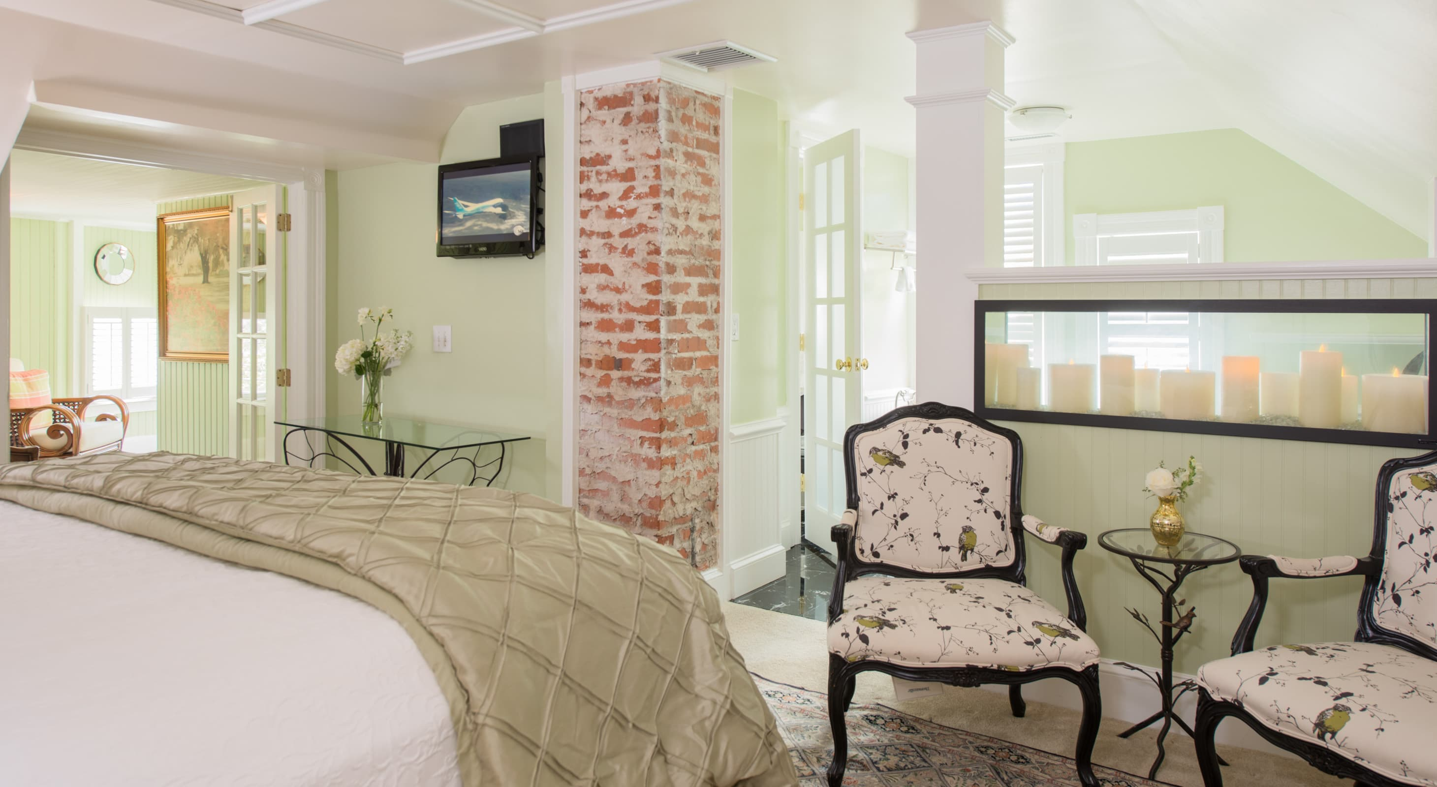 Large King Suite with Exposed Brick at Our Manteo North Carolina Inn