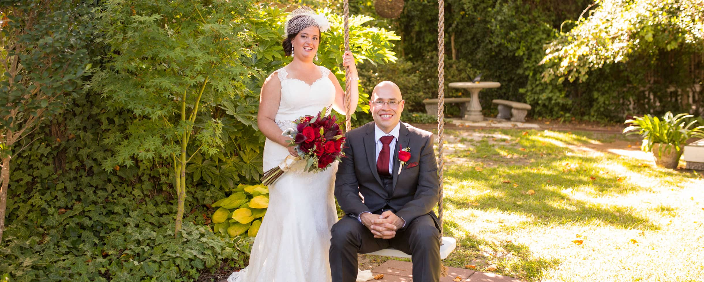 Bride standing next to her groom on a rope swing