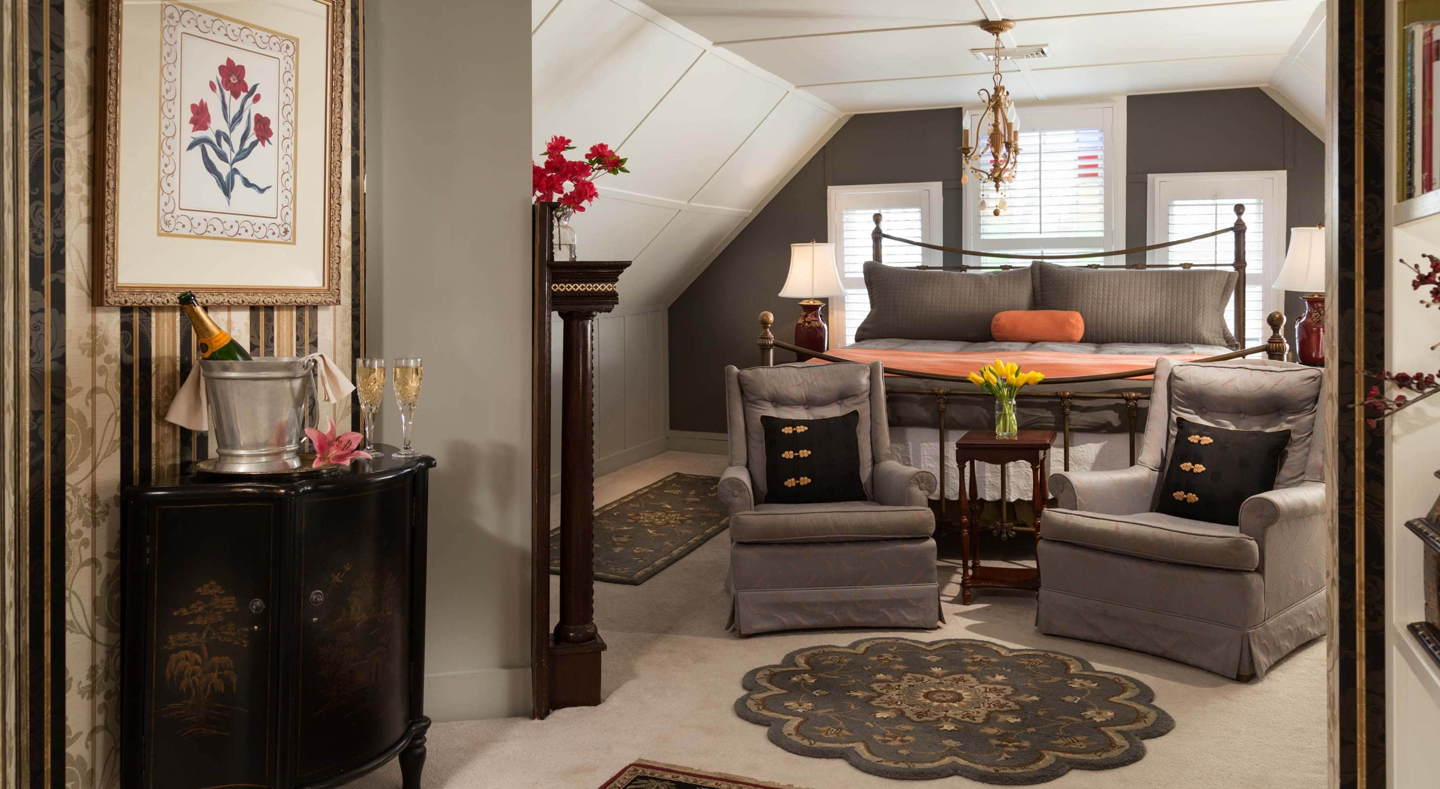 Spacious King Room in Grey and Orange at Our Roanoke Island Inn