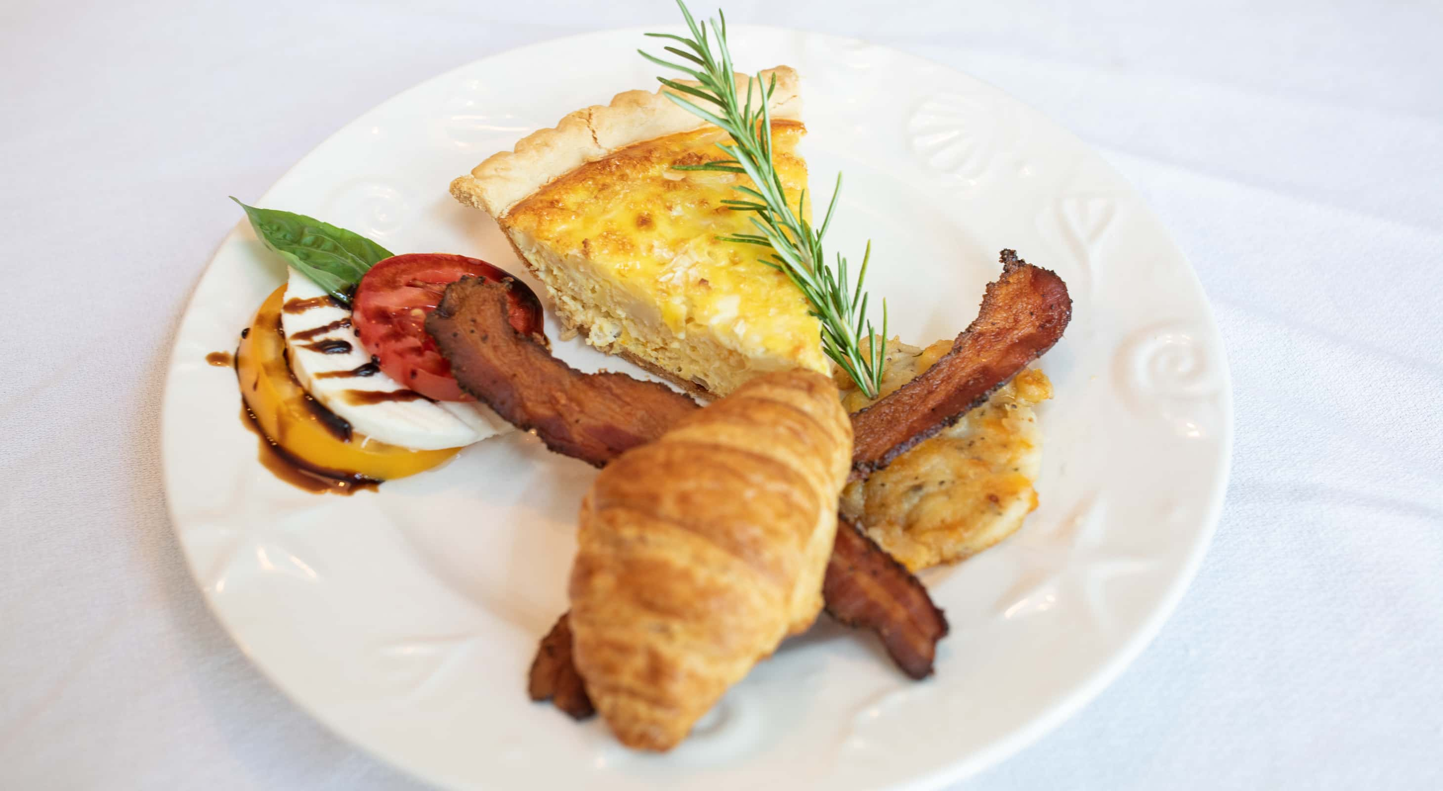 Breakfast Croissant, Quiche, Bacon, and Eggs