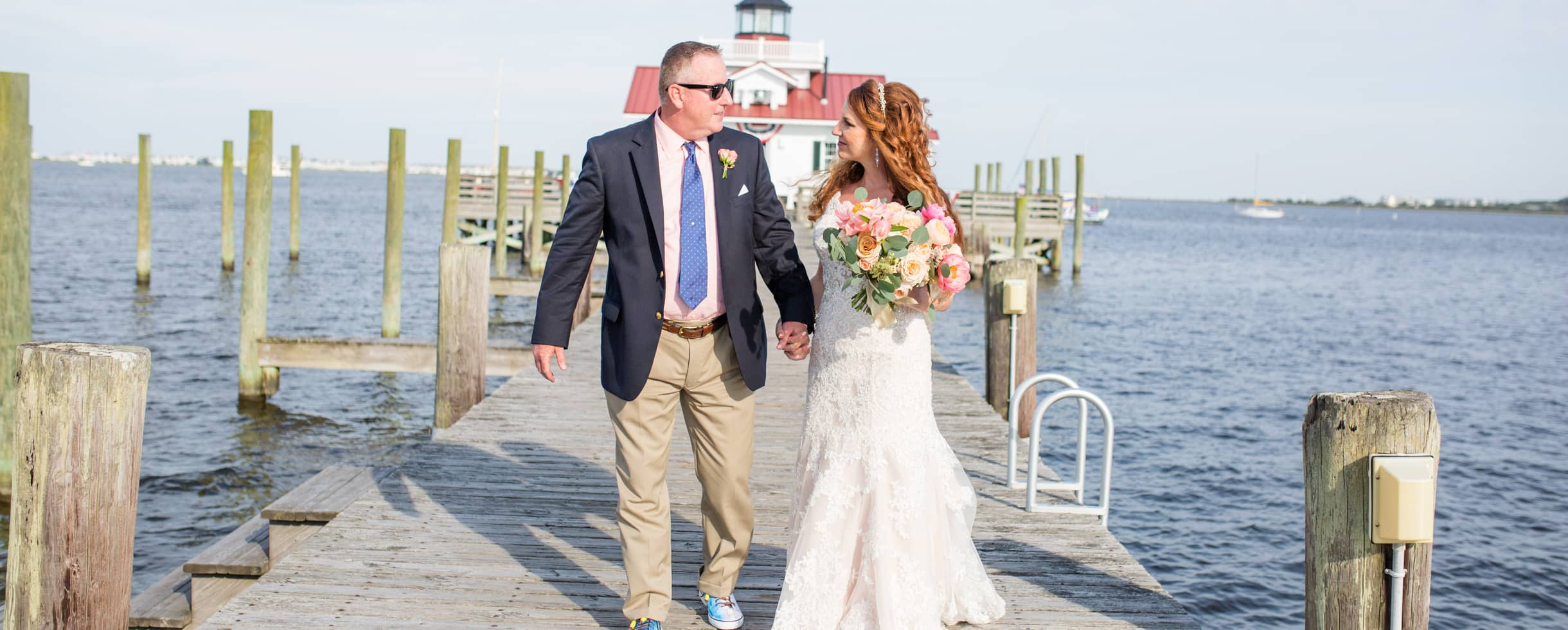 Bride and Groom on a pier near the waters edge