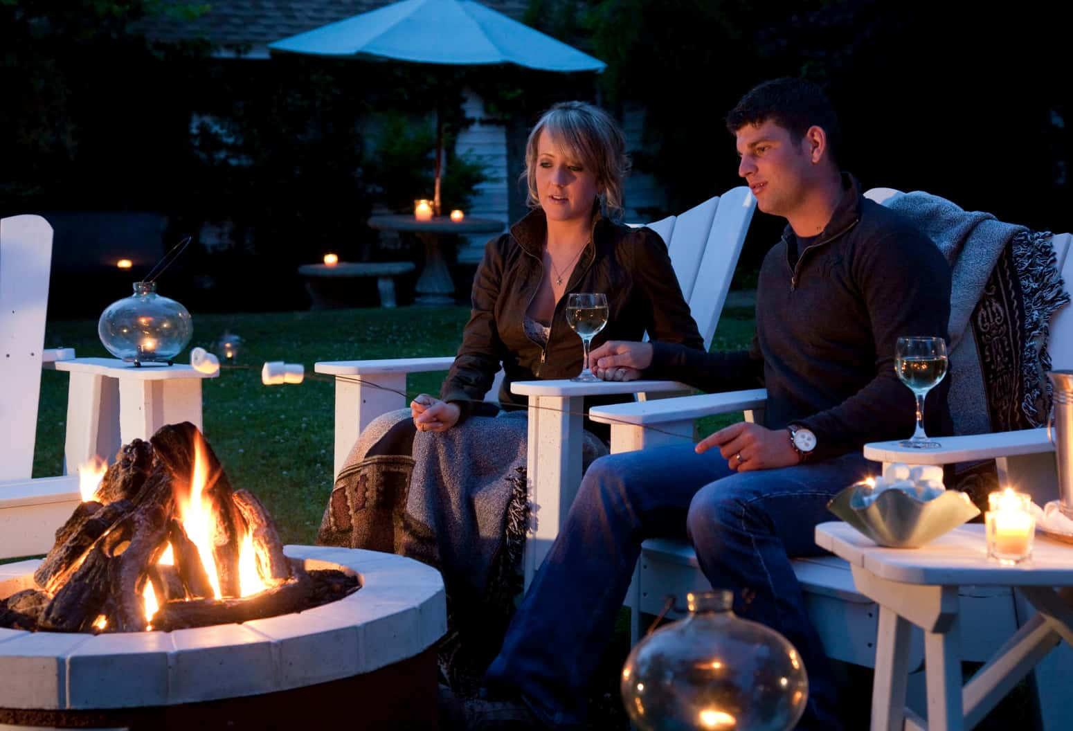 Couple Roasting Marshmallows at Our Outer Banks Boutique Hotel