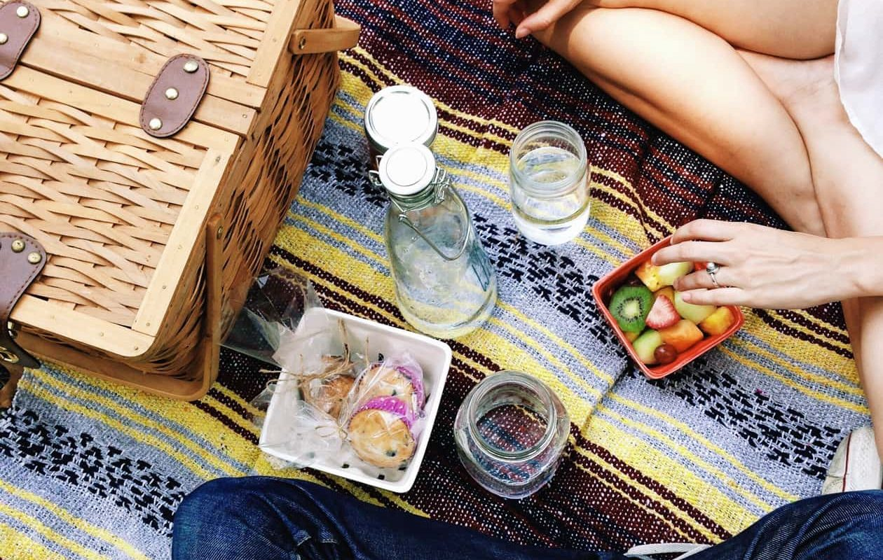 Two people enjoying a picnic together