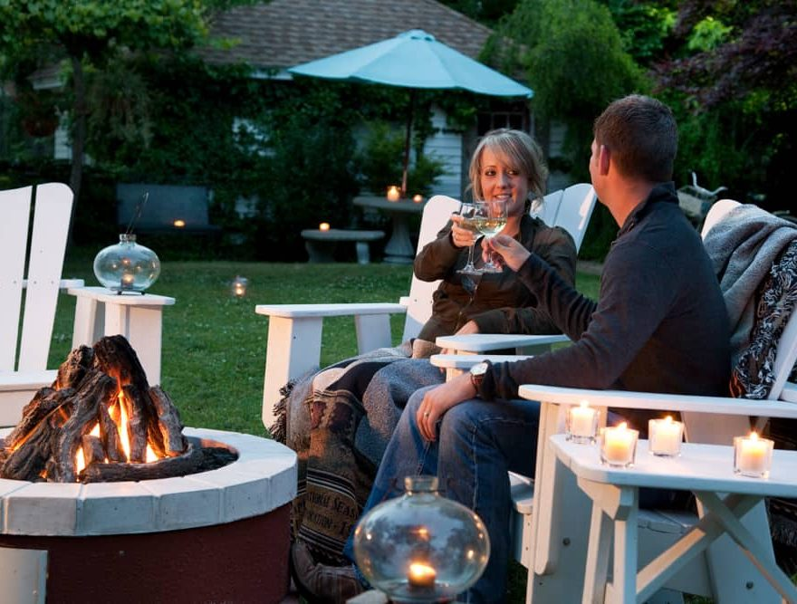 Couple by the Fire Pit on a Romantic Getaway in North Carolina
