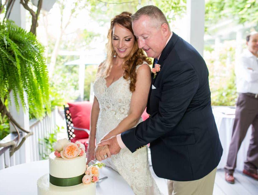Manteo Wedding Bride and Groom Cutting the Cake