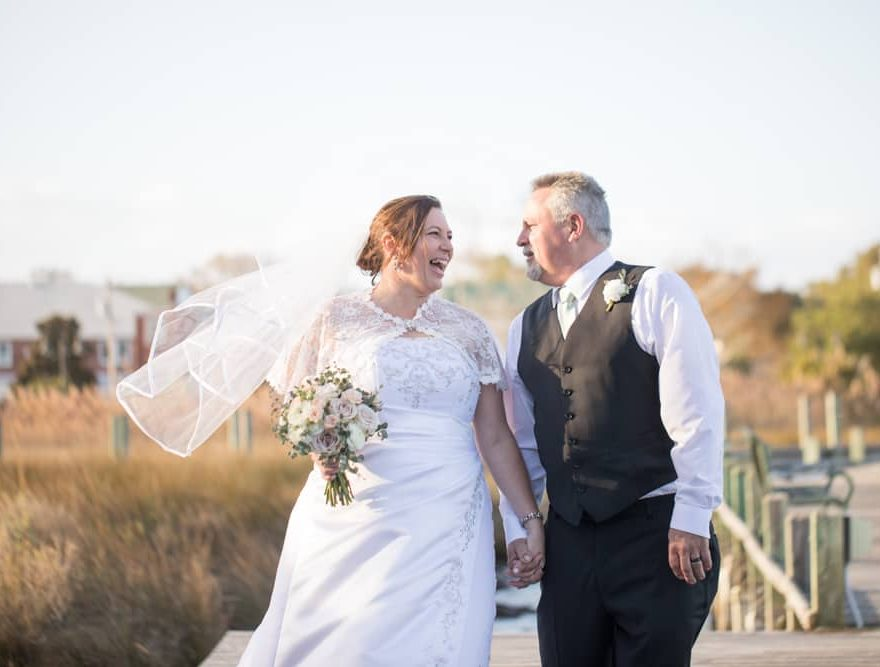 Couple Smiling After Their Roanoke Island Wedding Ceremony
