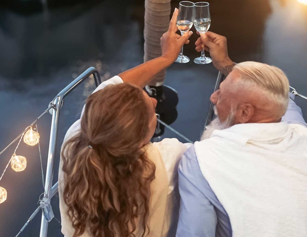 Couple toasting Champagne on a boat
