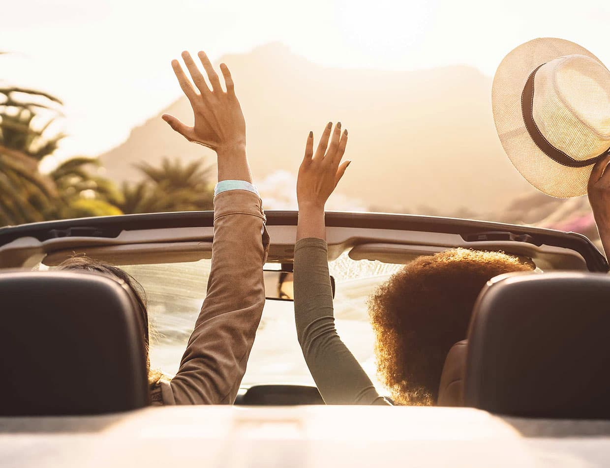 Couple in Convertible on Scenic East Coast Drive