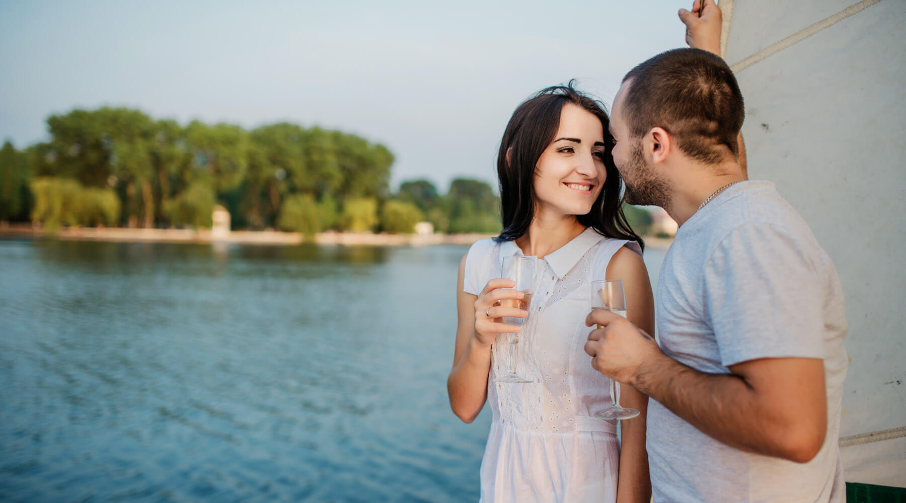 Couple drinking champagne on sailing trip to Outer Banks