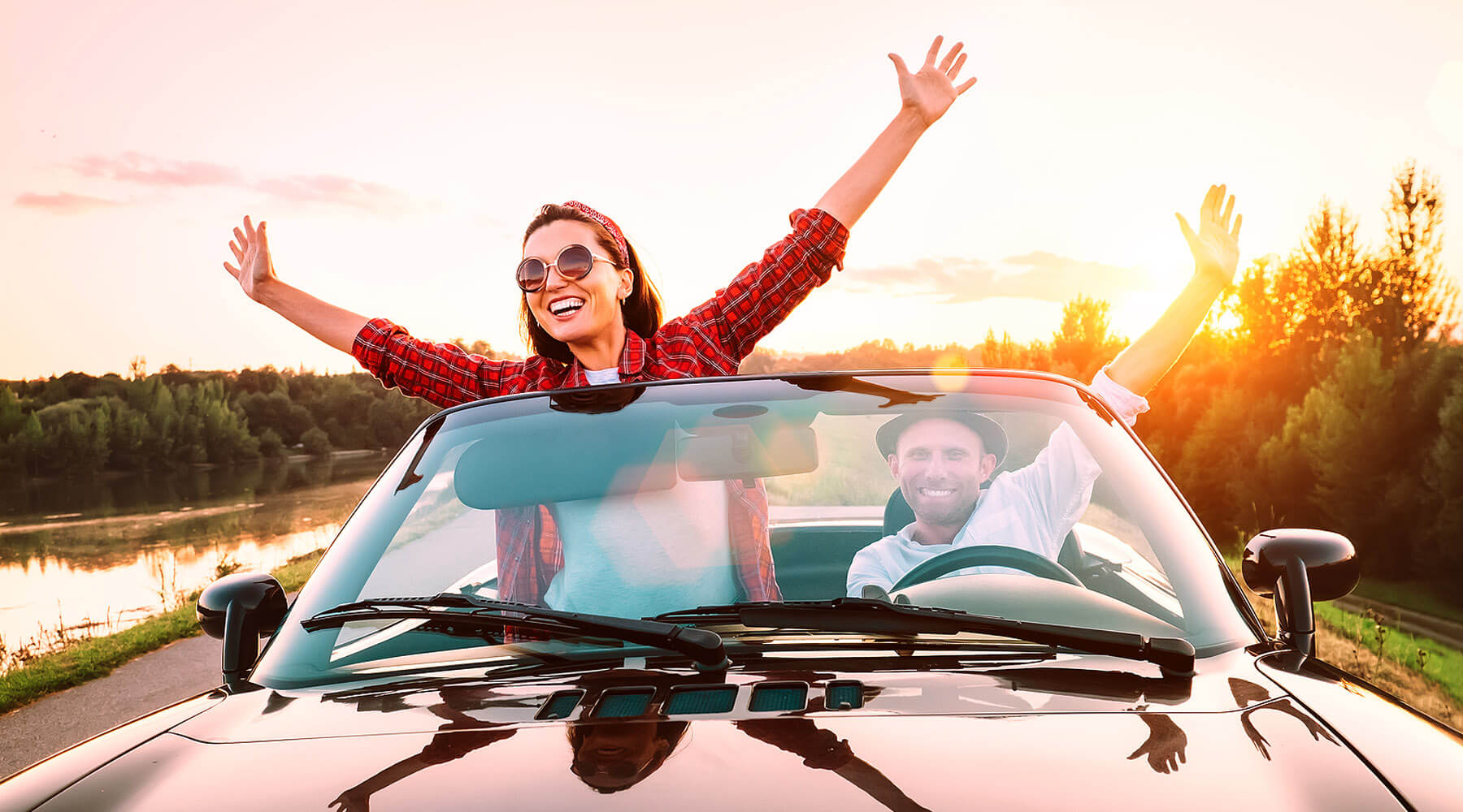Couple in convertible on Outer Banks scenic drive
