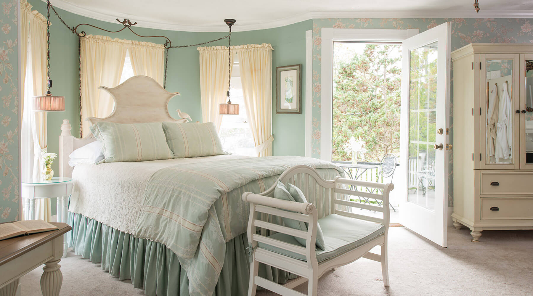 Guest room with private balcony on getaway from Raleigh