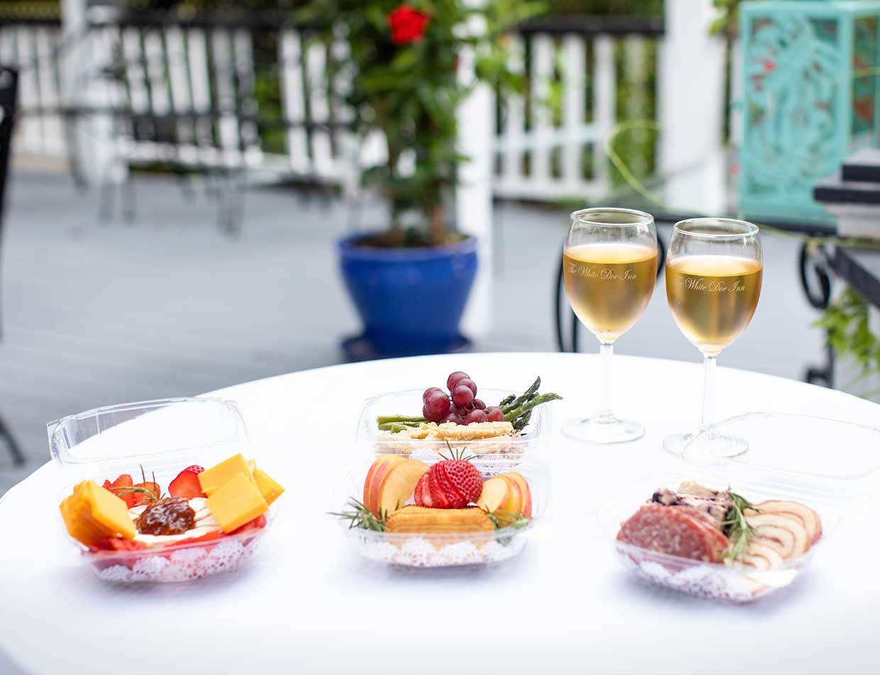 Appetizers and white wine on an outside table
