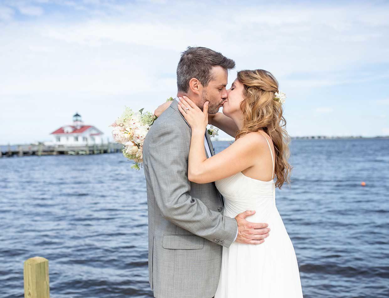 Couple eloping on the dock in Manteo, North Carolina