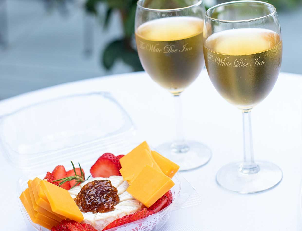 Appetizer and white wine on outdoor table