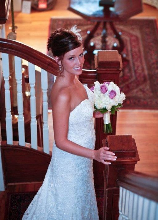 Bride walking down stairs on wedding day