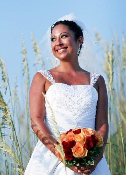 Bride smiling on beach wedding in Manteo