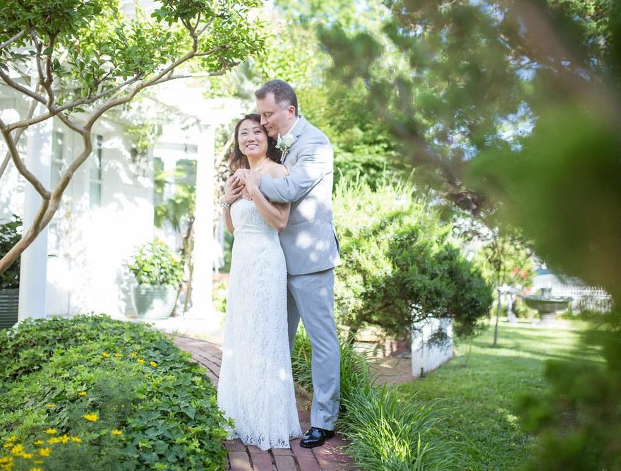 Bride and groom in the garden at an Outer Banks wedding