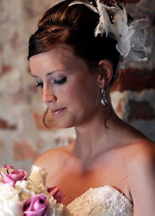 Bride looking at her flowers on wedding day