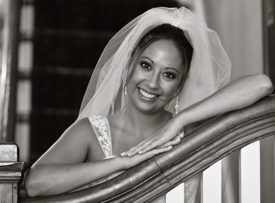 Bride smiling on stairs