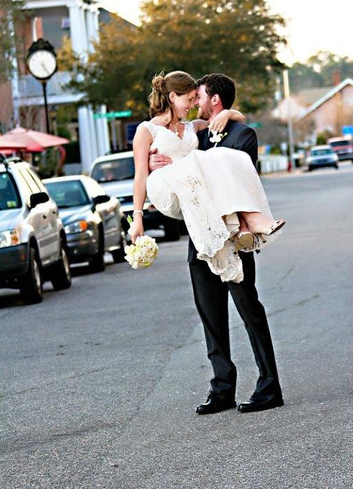 Groom holding bride in the street