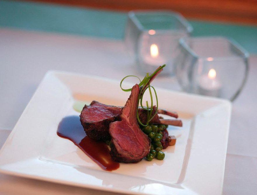 Rack of lamb on white plate