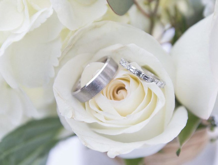 Outer Banks wedding bands in a white rose