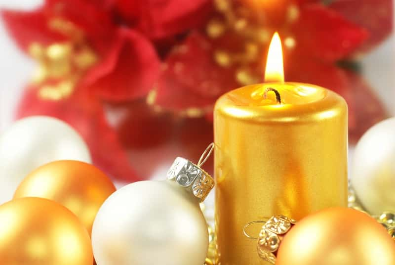 white and gold christmas bulbs and gold candle